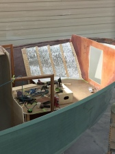 The forward cabin cabinetry is being roughed in.